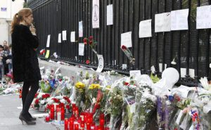 People leave flowers and light candles in tribute to the 13 November attacks in Paris outside the French Embassy in Madrid, Spain, 15 November 2015. At least 129 people have been killed in a series of attacks in Paris, France on 13 November 2015, according to French officials. Eight assailants were killed, seven when they detonated their explosive belts, and one when he was shot by officers, police said. EFE/Victor Lerena